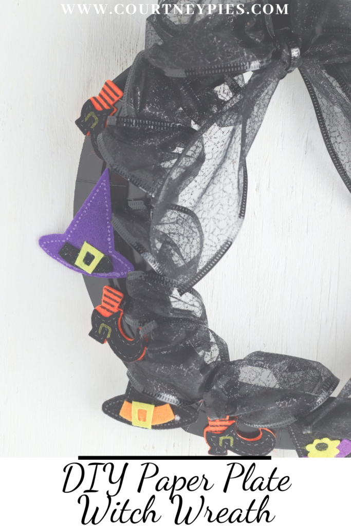 """Paper plate witch wreath with text that says """"DIY Paper Plate Witch Wreath"""""""